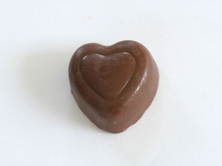 Chocolate heart on white photo