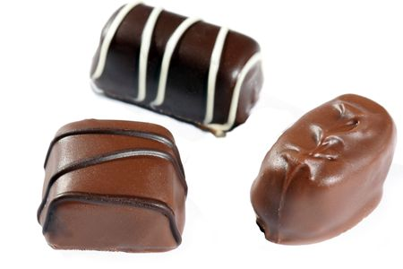 Closeup up of three dewey chocolates Stock Photo