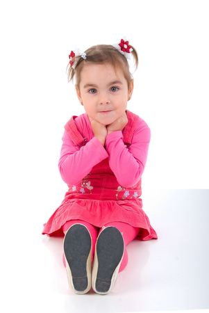 Sitting Girl Child In Pink Dress. Studio Shoot Over White Background. Stock Photo - 6082354