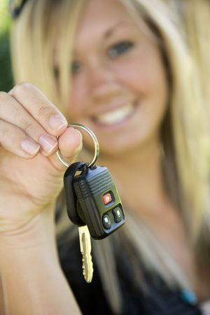 Model Release 358  Teenage girl holding out the keys to her car photo