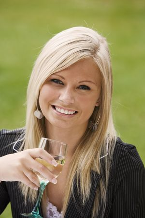 Model Release 351  Young woman relaxing with a glass of wine in an outdoor cafe photo