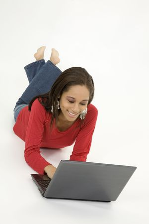 Model Release 379 African American teen working on laptop computer Stock Photo