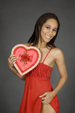 Model Release 379 African American woman posing on gray background in red lingerie with a Valentine heart photo