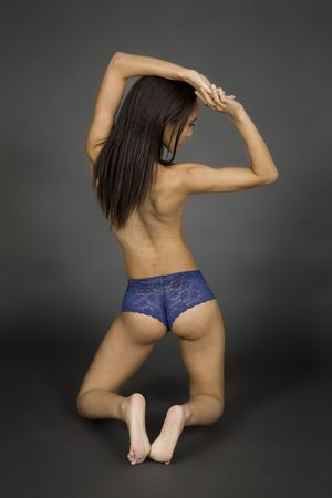 blue lingerie: Model Release 379 African American woman posing on gray background in blue panties Stock Photo