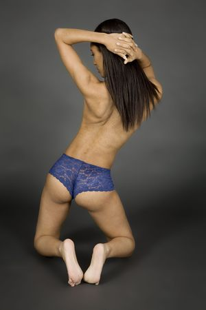 Model Release 379 African American woman posing on gray background in blue panties photo