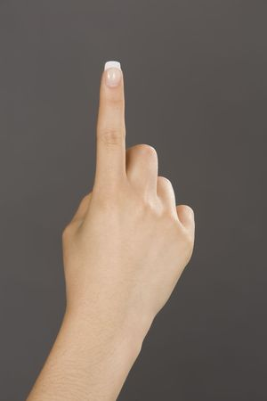hand gestures: Caucasian female using hand gestures by signing holding up one finger