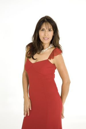 red evening: Beautiful Brazilian or Hispanic woman in a red evening gown on a white background