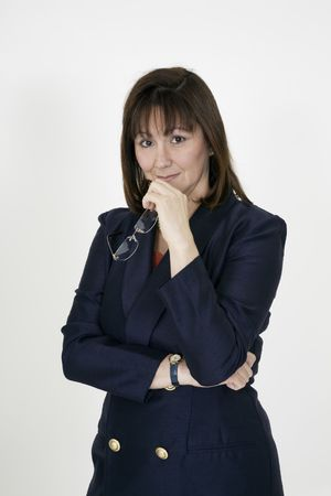 early 40s: Portrait of a adult caucasian woman in early 40s dressed in a blue business suit on white background