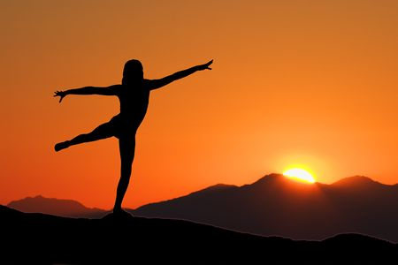 Young woman relaxing with early morning Yoga Stock Photo