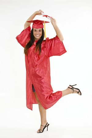 exuberance: A female caucasian in red graduation gown and very excited.  She is on a white background.