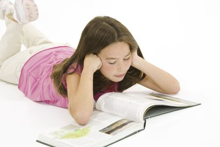 Child working on homework on white background