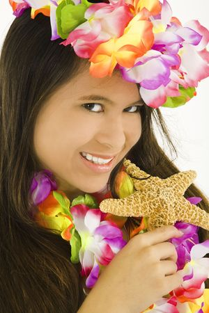 bathingsuits: Young Asian woman posing in a swimsuit with flowers and holding a starfish Stock Photo