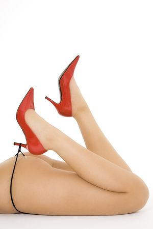 Very sexy Caucasian woman dressed in only red highheal shoes and a thong panties photo