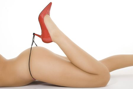 Very sexy Caucasian woman dressed in only red highheal shoes and a thong photo