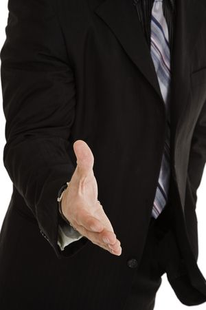 greet: Caucasian businessman holding out hand to greet someone