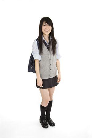 schulm�dchen: Portrait eines weiblichen asiatischen Teenager gekleidet in der traditionellen japanischen Schulm�dchen Kleidung. Uniformen sind getragen von den meisten der weiblichen Sch�ler in Japan. Sie steht auf einem wei�en Hintergrund und l�chelnd.  Lizenzfreie Bilder