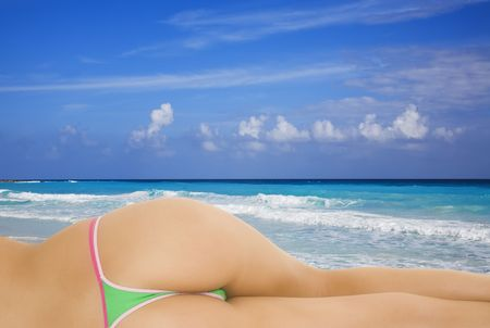 A very sexy caucasian woman enjoying the turquoise waters and white sand beaches of Cancun on the Yucatan Peninsula in Quintana Roo Mexico photo