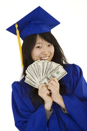 An Asian teenage in blue graduation gown and smiling while hold US money to illustrate to high cost of education.  She is on a white background.  photo