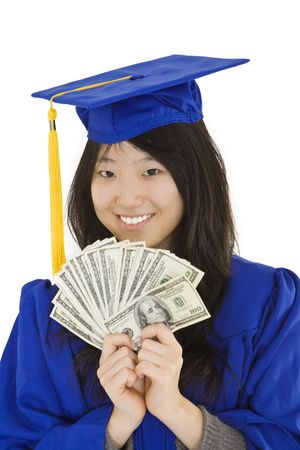 exuberance: An Asian teenage in blue graduation gown and smiling while hold US money to illustrate to high cost of education.  She is on a white background.