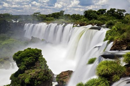 largest: Iguassu Falls is the largest series of waterfalls on the planet, located in Brazil, Argentina, and Paraguay.  At some times during the year one can see as many as 275 separate waterfalls cascading along the edges of 2,700 meters (1.6 miles) cliffs. Argent Stock Photo
