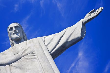 the redeemer: Christ the Redeemer on Corcovado Mountain, Rio de Janeiro  Brazil South America  The statue stands 38 m (125 feet) tall and is located at the peak of the 710-m (2330-foot) Corcovado mountain in the Tijuca Forest National Park, overlooking the city. As wel