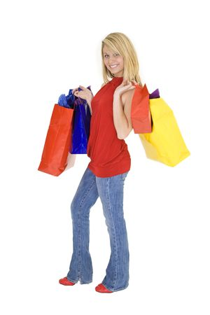 Beautiful Caucasian teen holding shopping bags while standing on a white background photo