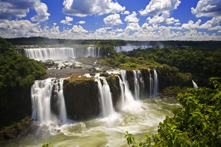 argent: Iguassu Falls is the largest series of waterfalls on the planet, located in Brazil, Argentina, and Paraguay.  At some times during the year one can see as many as 275 separate waterfalls cascading along the edges of 2,700 meters (1.6 miles) cliffs. Argent Stock Photo