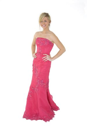 Caucasian teenager wearing a prom bress standing on a white background photo