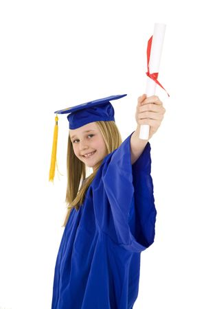 A preteen caucasian girl with blond hair standing in blue graduation gown and smiling.  She is on a white background.  photo