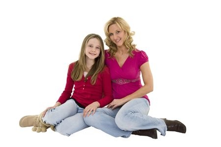 alike: Mother and daughter seting on a white background together in casual clothing Stock Photo