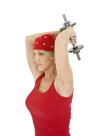 Caucasian woman in early 40s lifting weights using a dumbbell on a white background photo