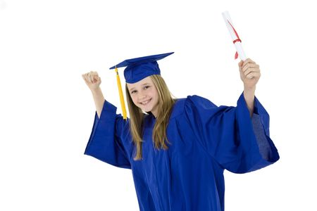 exuberance: A preteen caucasian girl with blond hair standing in blue graduation gown and smiling.  She is on a white background.  Stock Photo