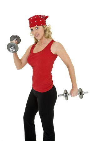 early 40s: Caucasian woman in early 40s lifting weights using a dumbbell on a white background