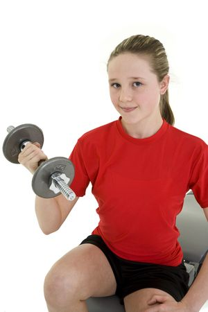 tween girl: Caucasian preteen female lifting weights using a dumbbell on a white background