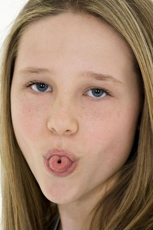 Caucasian preteen girl displaying some attitude by sticking out her tongue