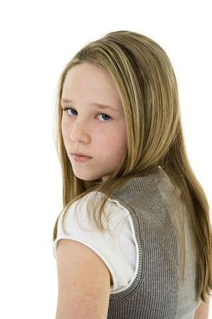tween girl: Caucasian preteen girl displaying some attitude while looking over shoulder