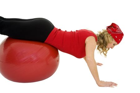 early 40s: Caucasian woman in early 40s using a excerise ball on a white background