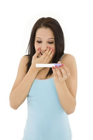 fertilize: Young Caucasian woman looking at pregnancy test