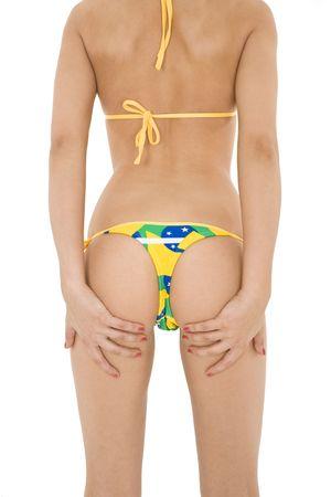 early 20s: Hermosa y sexy caucasian mujer de poco m�s de 20 a�os posando en un bikini tanga brasile�a sobre un fondo blanco  Foto de archivo