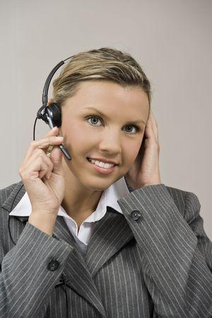early 30s: Caucasian businesswoman  secretary in her early 30s talking on a headset
