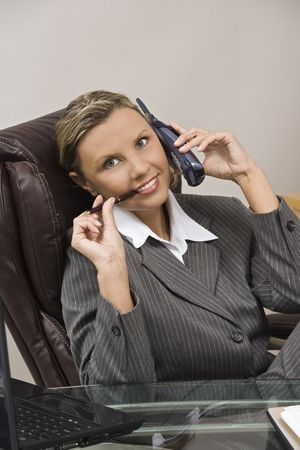 early 30s: Caucasian businesswoman  secretary in her early 30s talking on a headset