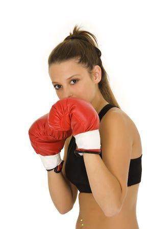 female boxer: Young Caucasian woman in red boxing gloves getting ready to fight