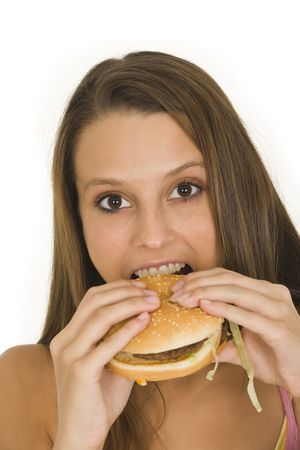 Caucasian woman eating a hambuger on a white background Stock Photo - 3280643