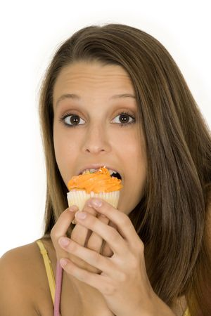 Caucasian woman eating a chocolate cupcake on a white background Stock Photo - 3335857