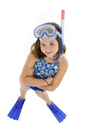 Caucasian child posing in a swimsuit standing on white background photo