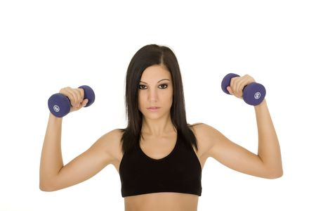 Beautiful Caucasian woman working out with dumbbells on white  photo