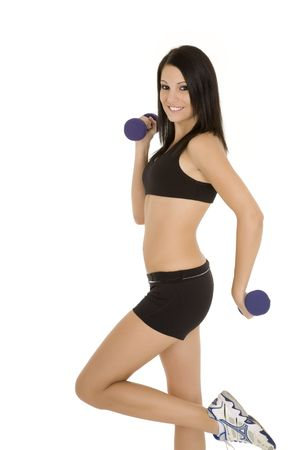 Beautiful Caucasian woman working out with dumbbells on white background photo