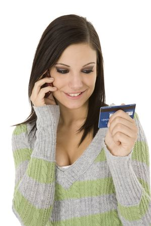 Beautiful Caucasian female using a credit card to make a purchase photo
