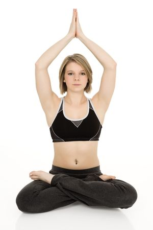 caucasian teenager practing yoga on a white background photo