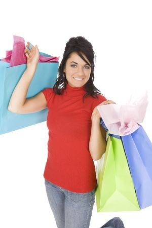 copysapce: Excited Caucasian woman holding shopping bags and smiling on white background Stock Photo